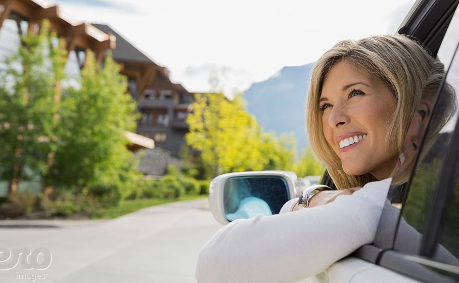 Woman Smiling out of car